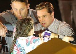 Brad Pitt socorre garotinha imprensada por multidão de fãs