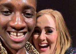 Adele convida fã ao palco e dá beijo nele sem querer!