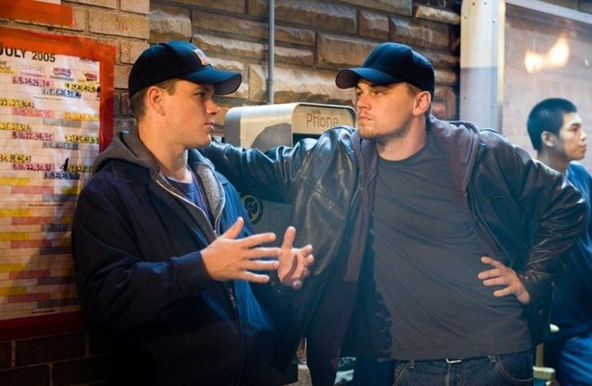 """MATT DAMON discusses a scene with LEONARDO DiCAPRIO on the set of Warner Bros. Pictures' crime drama """"The Departed.""""    PHOTOGRAPHS TO BE USED SOLELY FOR ADVERTISING, PROMOTION, PUBLICITY OR REVIEWS OF THIS SPECIFIC MOTION PICTURE AND TO REMAIN THE PROPERTY OF THE STUDIO. NOT FOR SALE OR REDISTRIBUTION."""