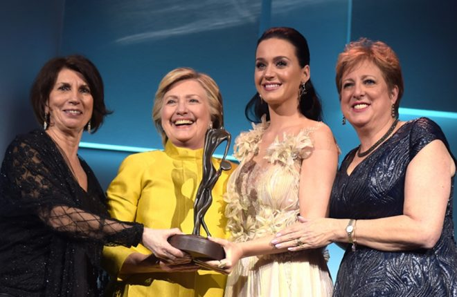 NEW YORK, NY - NOVEMBER 29:  (L-R) Pamela Fiori, Hillary Clinton, Katy Perry, and Caryl Stern speak on stage during the 12th annual UNICEF Snowflake Ball at Cipriani Wall Street on November 29, 2016 in New York City.  (Photo by Jason Kempin/Getty Images for UNICEF)