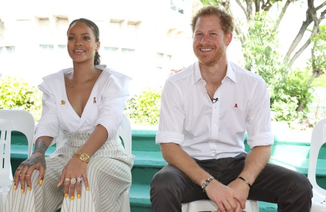 BRIDGETOWN, BARBADOS - DECEMBER 01:  Singer Rihanna and Prince Harry speak on stage at the 'Man Aware' event held by the Barbados National HIV/AIDS Commission on the eleventh day of an official visit on December 1, 2016 in Bridgetown, Barbados.  Prince Harry's visit to The Caribbean marks the 35th Anniversary of Independence in Antigua and Barbuda and the 50th Anniversary of Independence in Barbados and Guyana.  (Photo by Chris Jackson – Pool/Getty Images)