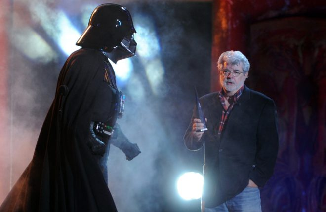 "UNIVERSAL CITY, CA - OCTOBER 15:  Darth Vader accepts the Ultimate Villain award from George Lucas onstage during Spike TV's ""SCREAM 2011"" awards held at Universal Studios on October 15, 2011 in Universal City, California.  (Photo by Kevin Winter/Getty Images)"