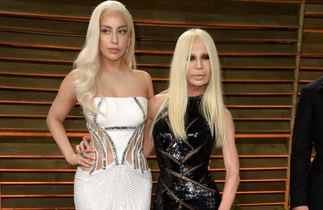 WEST HOLLYWOOD, CA - MARCH 02:  Musician Lady Gaga (L) and designer Donatella Versace attend the 2014 Vanity Fair Oscar Party hosted by Graydon Carter on March 2, 2014 in West Hollywood, California.  (Photo by Pascal Le Segretain/Getty Images)
