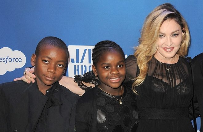 BEVERLY HILLS, CA - JANUARY 09:  (L-R) David Banda, Mercy James, musician Madonna and host Sean Penn attend the 5th Annual Sean Penn & Friends HELP HAITI HOME Gala benefiting J/P Haitian Relief Organization  at Montage Hotel on January 9, 2016 in Beverly Hills, California.  (Photo by Angela Weiss/Getty Images)