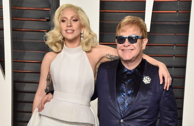 BEVERLY HILLS, CA - FEBRUARY 28:  Recording artists Lady Gaga (L) and Elton John attend the 2016 Vanity Fair Oscar Party Hosted By Graydon Carter at the Wallis Annenberg Center for the Performing Arts on February 28, 2016 in Beverly Hills, California.  (Photo by Pascal Le Segretain/Getty Images)