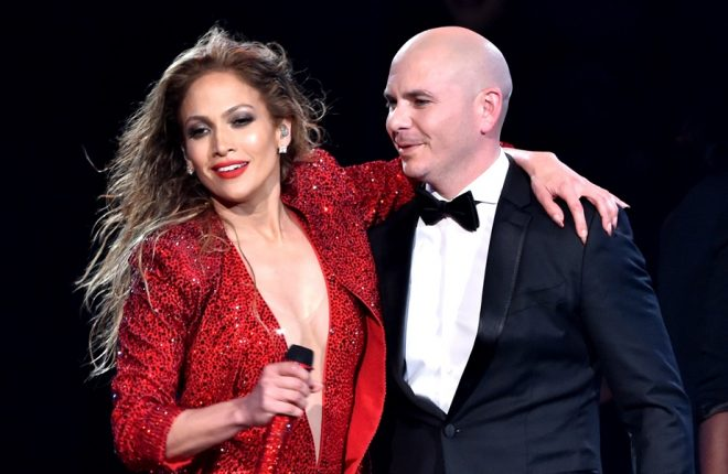 LOS ANGELES, CA - NOVEMBER 23:  Recording artist Jennifer Lopez (L) and host Pitbull perform onstage at the 2014 American Music Awards at Nokia Theatre L.A. Live on November 23, 2014 in Los Angeles, California.  (Photo by Kevin Winter/Getty Images)