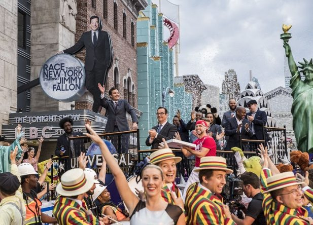 """On April 6, 2017, Race Through New York Starring Jimmy Fallon officially opened at Universal Orlando Resort. Hundreds of fans and Universal characters joined Jimmy Fallon in celebrating the opening with a ticker tape parade and ribbon cutting of epic proportions.   The new attraction gives guests the ultimate """"Tonight Show"""" experience and gets them up close and personal with the show's most hilarious segments before taking off on an action-packed race through New York against Jimmy Fallon himself. More info is available at UniversalOrlando.com.   © 2017 Universal Orlando Resort. All rights reserved."""