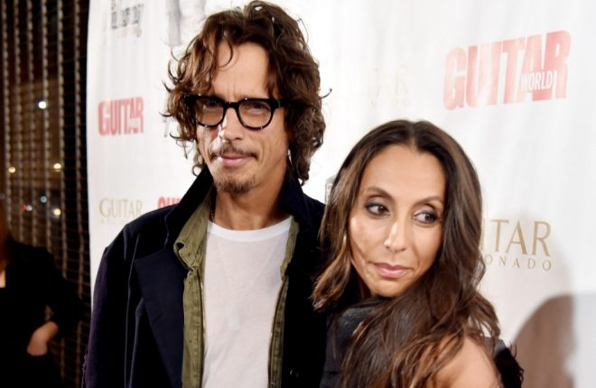 "LOS ANGELES, CA - NOVEMBER 12:  Musician Chris Cornell (L) and his wife Vicky Karayiannis arrive at ""An Evening With Jimmy Page And Chris Cornell In Conversation"" at the Ace Hotel on November 12, 2014 in Los Angeles, California.  (Photo by Kevin Winter/Getty Images)"