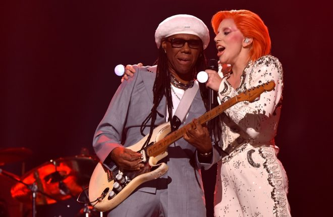LOS ANGELES, CA - FEBRUARY 15:  Musician/producer Nile Rodgers (L) and singer Lady Gaga perform a tribute to the late David Bowie onstage during The 58th GRAMMY Awards at Staples Center on February 15, 2016 in Los Angeles, California.  (Photo by Larry Busacca/Getty Images for NARAS)