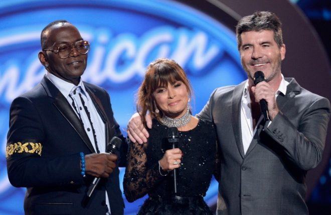 """HOLLYWOOD, CALIFORNIA - APRIL 07:  (L-R) Season 1 judges Randy Jackson, Paula Abdul and Simon Cowell speak onstage during FOX's """"American Idol"""" Finale For The Farewell Season at Dolby Theatre on April 7, 2016 in Hollywood, California. at Dolby Theatre on April 7, 2016 in Hollywood, California.  (Photo by Kevork Djansezian/Getty Images)"""