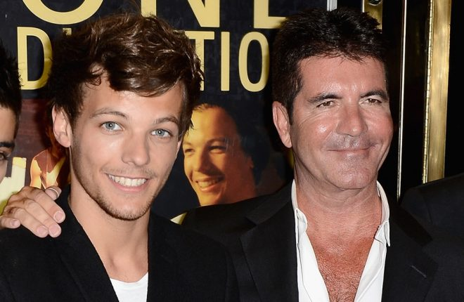 "LONDON, ENGLAND - AUGUST 20:  Simon Cowell (C) with (L-R) Niall Horan, Zayn Malik, Louis Tomlinson, Harry Styles and Liam Payne from One Direction attend the ""One Direction This Is Us"" world premiere at the Empire Leicester Square on August 20, 2013 in London, England.  (Photo by Ian Gavan/Getty Images for Sony Pictures)"