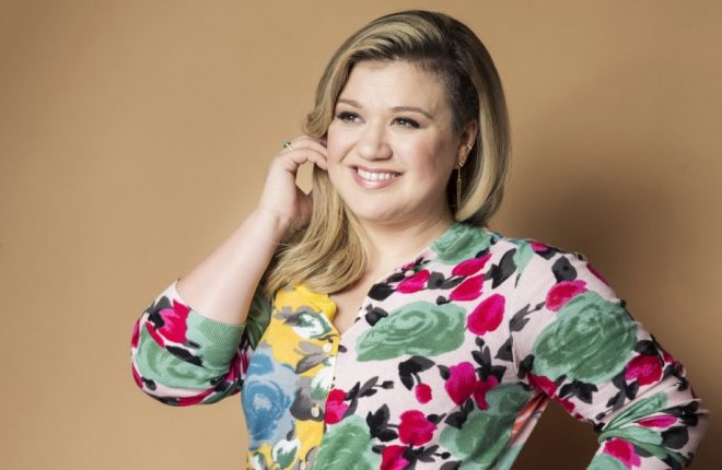 """FILE - In this March 4, 2015 file photo, American singer and songwriter Kelly Clarkson poses for a portrait to promote her album """"Piece by Piece"""" in New York. On Thursday, April 14, 2016, Clarkson announced on Twitter the birth of her second child, a baby boy named Remington Alexander Blackstock. He was born on Tuesday and is Clarkson's second child with husband Brandon Blackstock. The couple also have a daughter named River Rose who was born in 2014. (Photo by Victoria Will/Invision/AP, File)"""